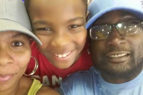 Keith Lamont Scott with wife and son